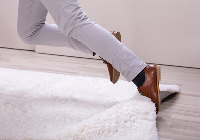 Man Stumble In A Carpet Near Ladder