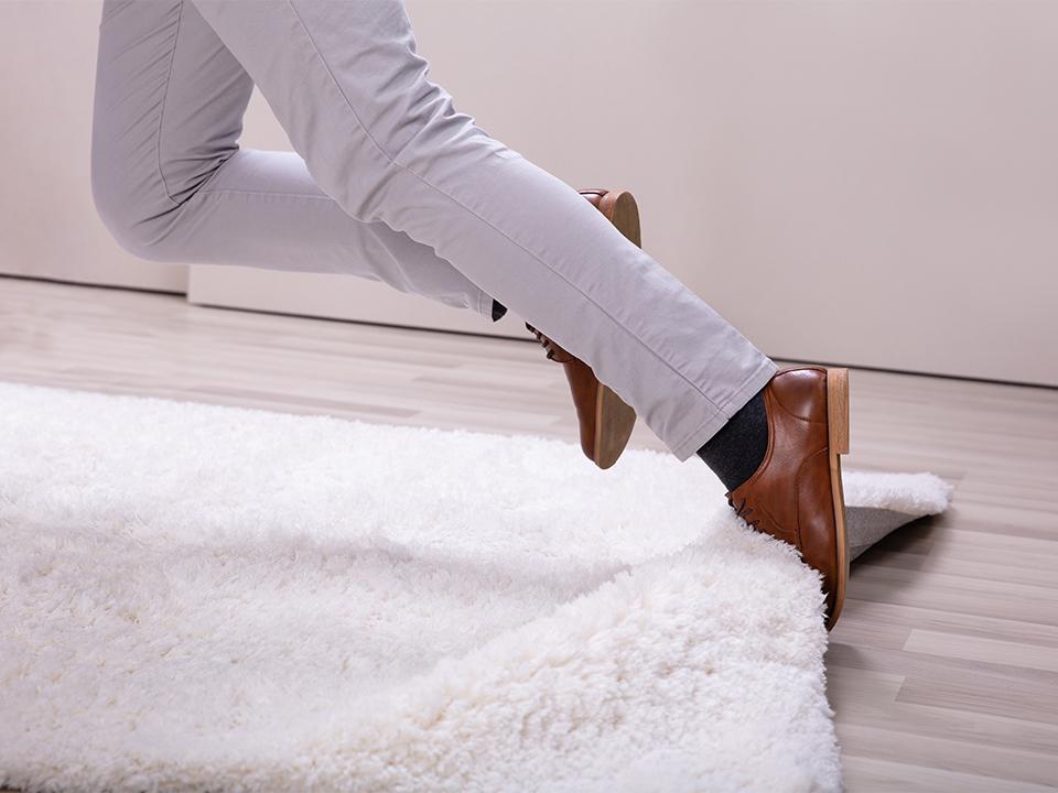Man Stumble In A Carpet Near Ladder
